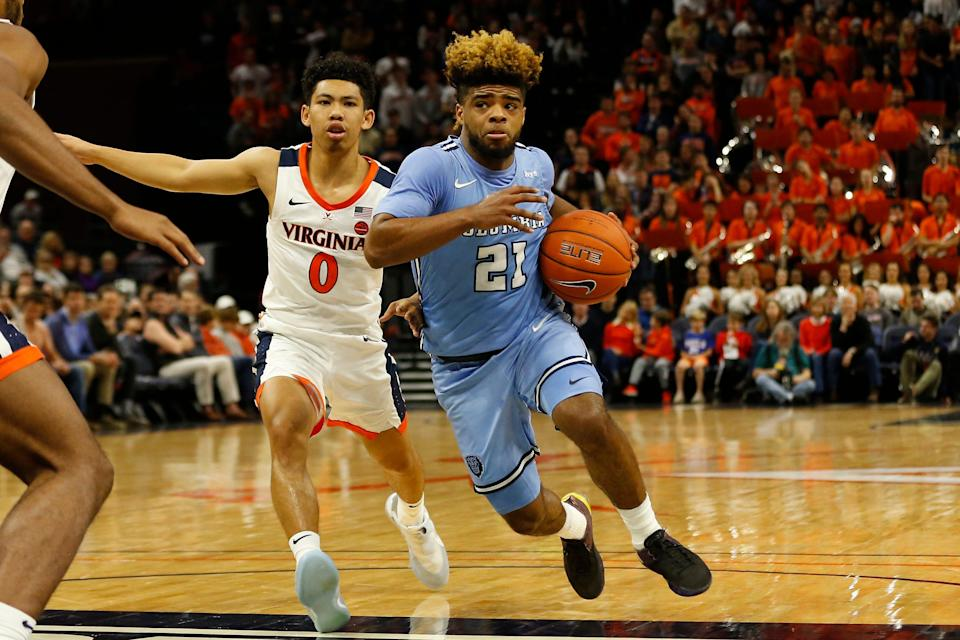 Columbia Lions guard Mike Smith drives to the basket past Virginia Cavaliers guard Kihei Clark.