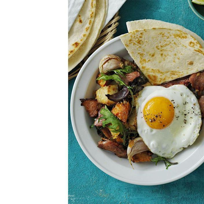 """<p>Serve this hearty poblano and hash dish with a side of tortillas to soak up that egg yolk.</p><p><a href=""""https://www.womansday.com/food-recipes/food-drinks/recipes/a58141/roasted-poblano-potato-ham-hash/?visibilityoverride"""" rel=""""nofollow noopener"""" target=""""_blank"""" data-ylk=""""slk:Get the Roasted Poblano Potato and Ham Hash recipe."""" class=""""link rapid-noclick-resp""""><em>Get the Roasted Poblano Potato and Ham Hash recipe.</em></a></p>"""