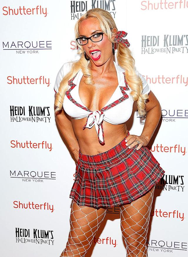 <p>Oh, Coco! Ice-T's wife dressed as a sexy student — or do the glasses mean she's a sexy teacher? — for a Halloween fete. (Photo: Cindy Ord/Getty Images for Heidi Klum) </p>