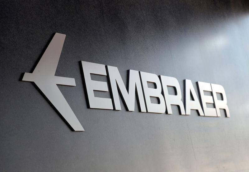 FILE PHOTO: The Embraer logo at an exhibition in Sao Paulo