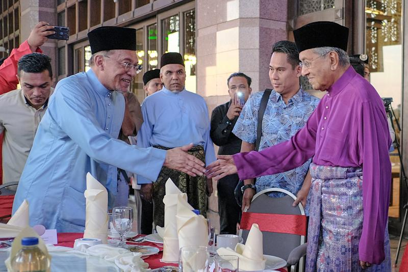 Prime Minister Tun Dr Mahathir Mohamad greets Datuk Seri Anwar Ibrahim before special thanksgiving prayers and iftar in Putrajaya May 9, 2019. — Picture by Mukhriz Hazim