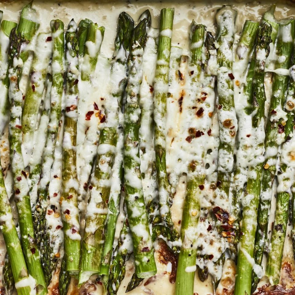 """<p>In this cheesy baked asparagus recipe, asparagus spears are roasted whole smothered in a creamy, cheesy garlic sauce. This low-carb side dish is a great way to entice picky eaters to eat their veggies! Pair it with roast chicken or steak. <a href=""""http://www.eatingwell.com/recipe/278000/cheesy-asparagus/"""" rel=""""nofollow noopener"""" target=""""_blank"""" data-ylk=""""slk:View recipe"""" class=""""link rapid-noclick-resp""""> View recipe </a></p>"""