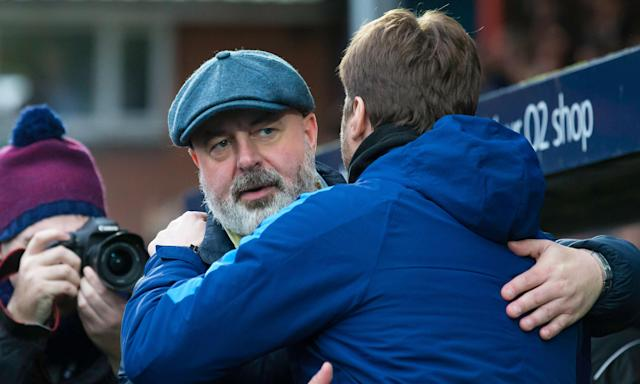 Mauricio Pochettino congratulates Rochdale's manager, Keith Hill, after the third-tier side's dramatic draw with the Premier League giants at Spotland.