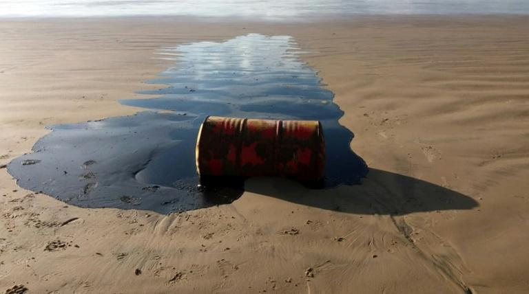 A barrel of oil spilled on a beach in Barra dos Coqueiros municipality, Sergipe state, Brazil, is pictured in September 2019 in a handout photo from the Sergipe State Environment Administration