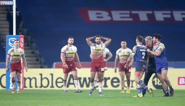 Wigan players show their disappointment at losing