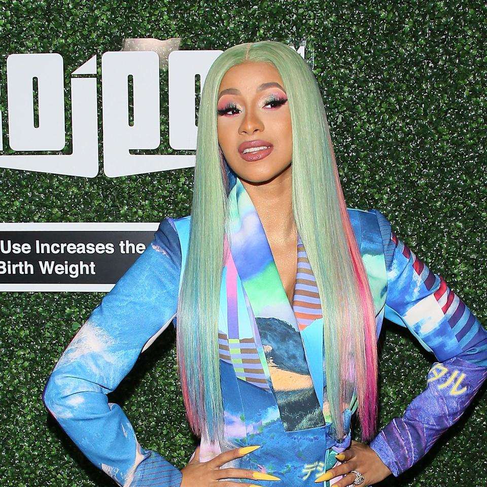 Pastels can never go out of style, and Cardi proves it. We love this sea foam-colored, waist-grazing hair Cardi wore to the Swisher Sweet Awards in April 2019. The light blue and hot pink streaks that peek out underneath are an amazing touch.