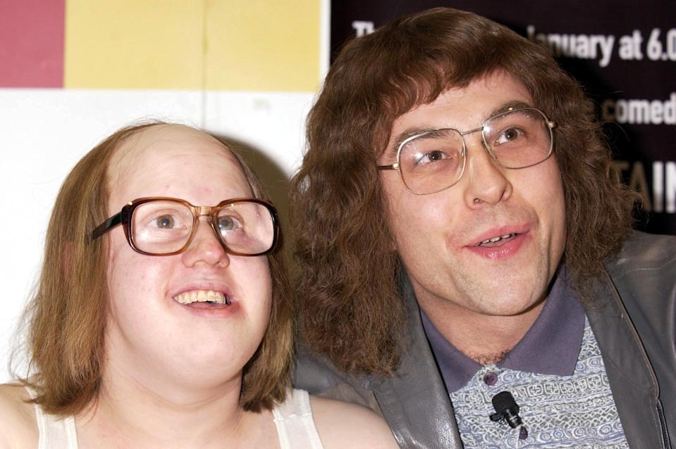 Comedians Matt Lucas as Andy (in wheelchair) and David Walliams as Lou, during a photocall for the signing of their new comedy audio CD 'Little Britain', based on the BBC radio series, at the Virgin  Megastore in Piccadilly, central London.   (Photo by Yui Mok - PA Images/PA Images via Getty Images)