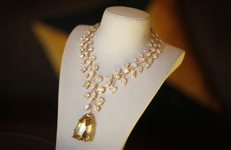 Rose gold necklace with a 407 carat yellow diamond is presented on a stand during a media event in Singapore