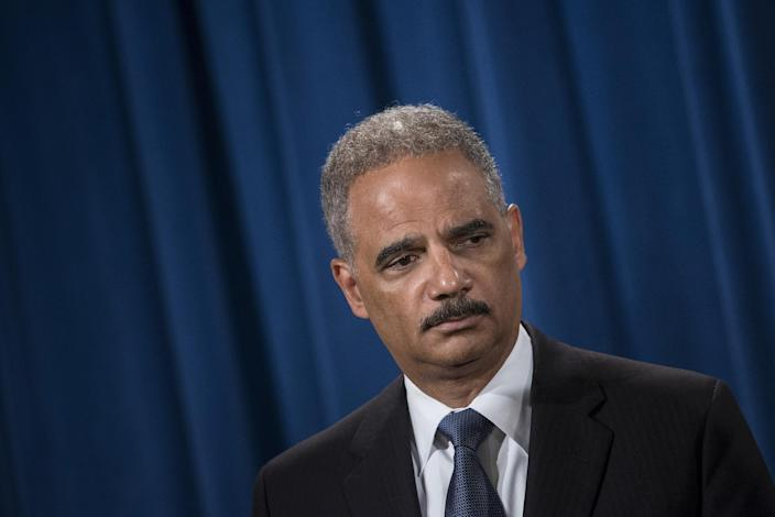 US Attorney General Eric Holder listens to questions during a press conference at the Department of Justice on September 4, 2014 in Washington, DC (AFP Photo/Brendan Smialowski)