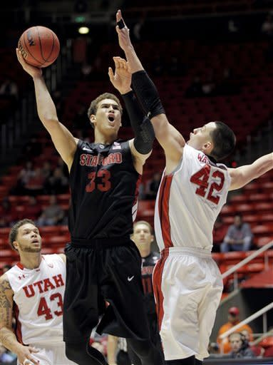Stanford forward Dwight Powell (33) shoots over Utah center Jason Washburn (42) during the first half of an NCAA college basketball game, Sunday, Jan. 27, 2013, in Salt Lake City. (AP Photo/Steve C. Wilson)