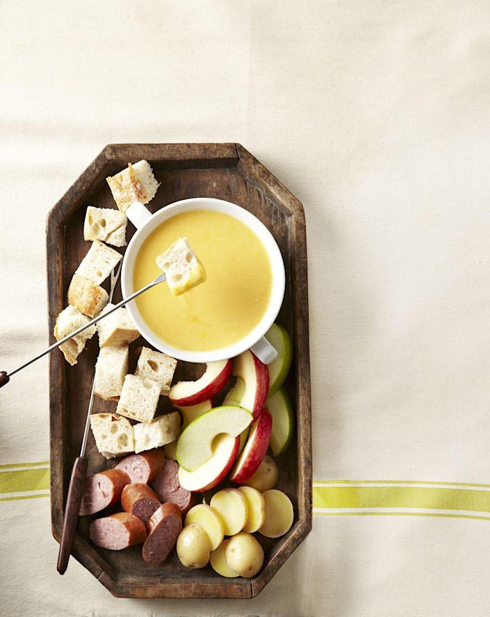 """<p>This boozy spread makes a great appetizer for any party. And there are tons more ways you can <a href=""""https://www.goodhousekeeping.com/holidays/more-holidays/recipes-with-beer"""" rel=""""nofollow noopener"""" target=""""_blank"""" data-ylk=""""slk:cook with your Irish stout"""" class=""""link rapid-noclick-resp"""">cook with your Irish stout</a>, if you want to start a theme.</p><p><a class=""""link rapid-noclick-resp"""" href=""""https://www.amazon.com/Prepworks-Progressive-Ceramic-Included-Dishwasher/dp/B00004RDF3?tag=syn-yahoo-20&ascsubtag=%5Bartid%7C10055.g.981%5Bsrc%7Cyahoo-us"""" rel=""""nofollow noopener"""" target=""""_blank"""" data-ylk=""""slk:SHOP FONDUE SETS"""">SHOP FONDUE SETS</a></p><p><a href=""""https://www.goodhousekeeping.com/recipefinder/cheddar-beer-fondue-recipe-ghk0213"""" rel=""""nofollow noopener"""" target=""""_blank"""" data-ylk=""""slk:Get the recipe for Cheddar-Beer Fondue »"""" class=""""link rapid-noclick-resp""""><em>Get the recipe for Cheddar-Beer Fondue »</em></a></p>"""