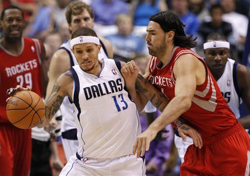 Dallas Mavericks' Delonte West (13) comes away with a steal against Houston Rockets' Luis Scola, right, of Argentina,in the first half of an NBA basketball game on Wednesday, April 18, 2012, in Dallas. (AP Photo/Tony Gutierrez)