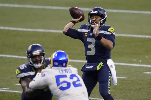 Seattle Seahawks quarterback Russell Wilson (3) passes for a touchdown against the Los Angeles Rams during the second half of an NFL football game, Sunday, Dec. 27, 2020, in Seattle. The Seahawks won 20-9. (AP Photo/Elaine Thompson)