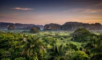 "Cuba's western, inland province of Pinar del Río is a treasure trove of natural wonders, with miles of mountain ranges and tobacco fields (hello, cigars). The region also happens to encompass Viñales Valley, arguably one of the most beautiful spots in the entire country. With its dome-like limestone formations and lush landscapes, the <a href=""https://www.cntraveler.com/galleries/2014-12-23/most-beautiful-unesco-world-heritage-sites-galapagos-taj-mahal-yosemite?mbid=synd_yahoo_rss"" rel=""nofollow noopener"" target=""_blank"" data-ylk=""slk:UNESCO World Heritage Site"" class=""link rapid-noclick-resp"">UNESCO World Heritage Site</a> is the perfect place to watch the sun set. Don't get so enthralled by this province that you get stuck, though: the bright architecture of Old Havana and the beauty of Varadero beach are reasons enough to explore the whole island."