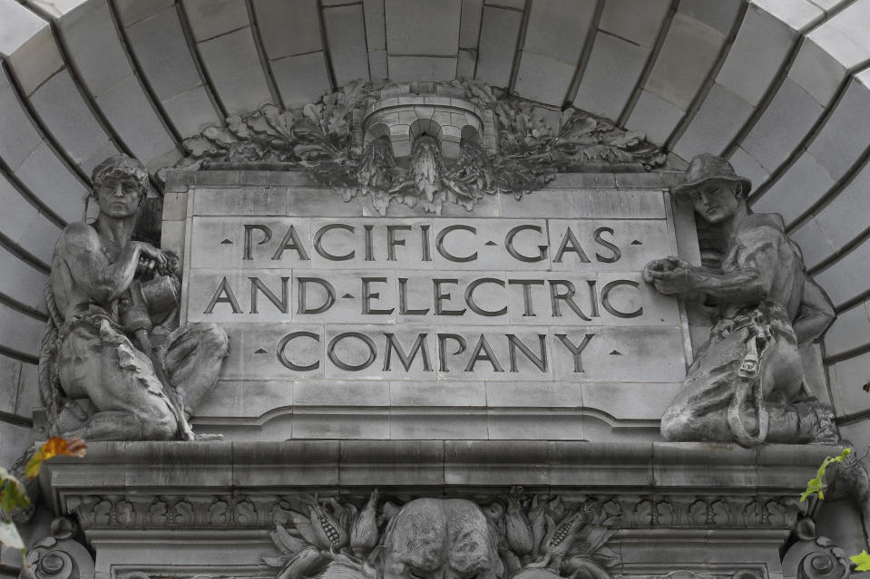 FILE - In this April 16, 2020, file photo, a Pacific Gas & Electric sign is displayed on the exterior of a PG&E building in San Francisco. Pacific Gas & Electric will cut power to over 1 million people on Sunday to prevent the chance of sparking wildfires as extreme fire weather returns to the region, the utility announced Friday, Oct. 23, 2020. (AP Photo/Jeff Chiu, File)
