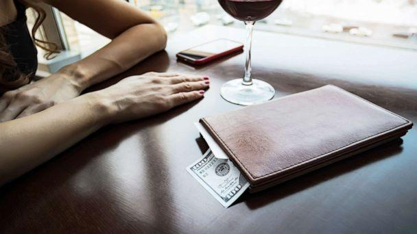 PHOTO: A hundred dollars generous tip sits on the table in a leather folder in an undated stock image. (STOCK IMAGE/Shutterstock)