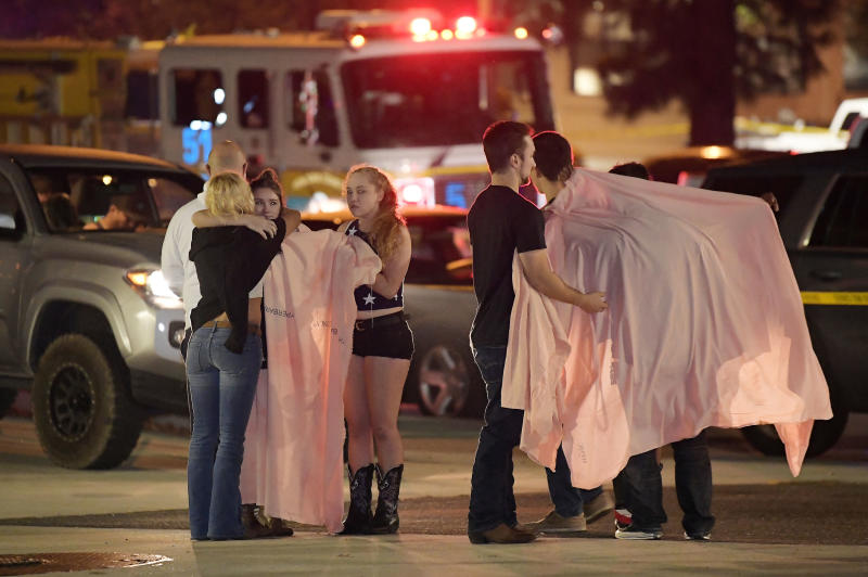 Shocked bystanders are treated at the scene in Thousand Oaks California. More