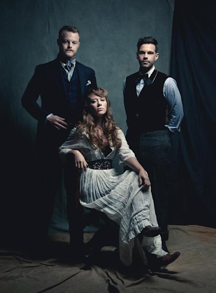 This publicity image released by Descendant Records shows members of The Lone Bellow, from left, Brian Elmquist, Kanene Pipkin, seated, and Zach Williams. (AP Photo/Descendant Records)