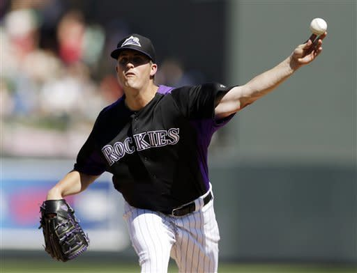 Colorado Rockies starting pitcher Drew Pomeranz throws to the Seattle Mariners during the third inning of an exhibition spring training baseball game, Saturday, March 16, 2013, in Scottsdale, Ariz. (AP Photo/Marcio Jose Sanchez)
