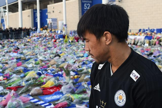 Leicester City's Japanese striker Shinji Okazaki looks at the floral tributes (Photo by Mike Egerton/PA Images via Getty Images)