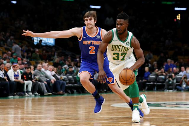 BOSTON, MA - DECEMBER 6: Semi Ojeleye #37 of the Boston Celtics drives against Luke Kornet #2 of the New York Knicks during the game between the Boston Celtics and the New York Knicks at TD Garden on December 6, 2018 in Boston, Massachusetts. (Photo by Maddie Meyer/Getty Images)