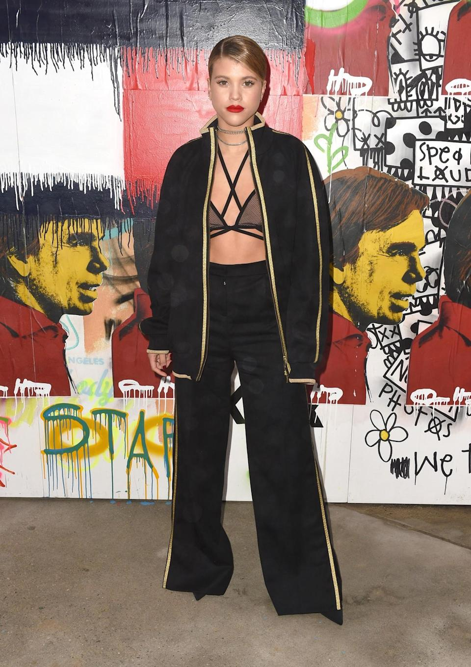 <p>Sofia Richie chose an oversized black tracksuit with gold piping. <i>[Photo: Getty]</i> </p>