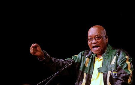 South Africa's President Zuma gestures at the ANC in Soweto