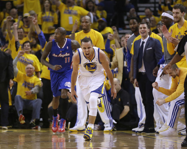 Golden State Warriors' Stephen Curry (30) celebrates after scoring next to Los Angeles Clippers' Jamal Crawford (11) during the first half in Game 4 of an opening-round NBA basketball playoff series on Sunday, April 27, 2014, in Oakland, Calif. (AP Photo/Marcio Jose Sanchez)