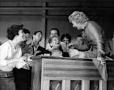 """<p>Lucille is in stitches as she works with young aspiring actresses in her acting class, The Desilu Workshop. The actress, who attended drama school in New York City, was initially <a href=""""https://www.biography.com/actor/lucille-ball"""" rel=""""nofollow noopener"""" target=""""_blank"""" data-ylk=""""slk:told that she was too shy"""" class=""""link rapid-noclick-resp"""">told that she was too shy</a> to become a successful performer. </p>"""