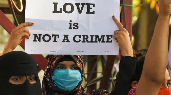 "Women protesting against the proposed passing of ""Love Jihad"" law"