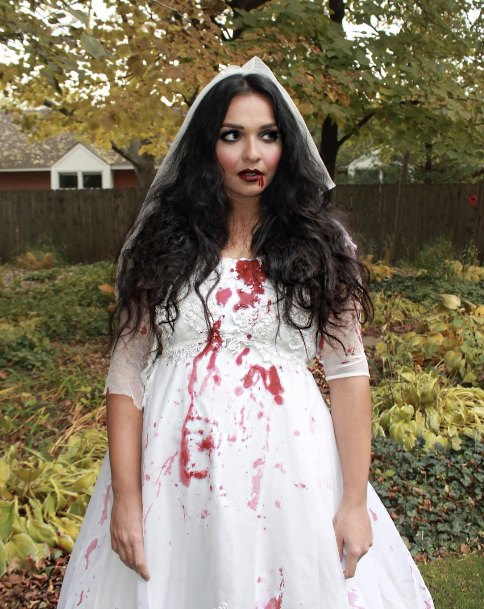 """<p>Splatter some fake blood onto a frilly white dress, then top with a veil. Just like that, you're a zombie bride. </p><p><a class=""""link rapid-noclick-resp"""" href=""""https://www.instagram.com/p/BphP_BmFK8y/"""" rel=""""nofollow noopener"""" target=""""_blank"""" data-ylk=""""slk:GET THE TUTORIAL"""">GET THE TUTORIAL</a></p><p><a class=""""link rapid-noclick-resp"""" href=""""https://www.amazon.com/Kangaroo-Vampire-Blood-Gel-Bottle/dp/B01EXAATKS/?tag=syn-yahoo-20&ascsubtag=%5Bartid%7C10072.g.33547559%5Bsrc%7Cyahoo-us"""" rel=""""nofollow noopener"""" target=""""_blank"""" data-ylk=""""slk:SHOP VAMPIRE BLOOD GEL"""">SHOP VAMPIRE BLOOD GEL</a></p>"""