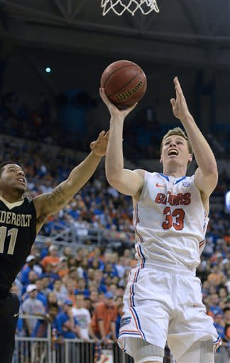 Florida's Erik Murphy (33) drives to the basket against Vanderbilt guard Kyle Fuller (11) during the first half of an NCAA college basketball game in Gainesville, Fla., Wednesday, March 6, 2013. (AP Photo/Phil Sandlin)
