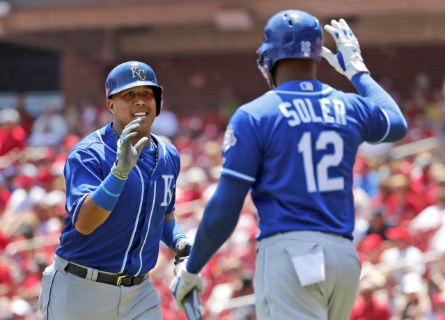 Kansas City Royals' Salvador Perez, left, is congratulated by teammate Jorge Soler (12) after hitting a solo home run during the second inning of a baseball game against the St. Louis Cardinals Wednesday, May 23, 2018, in St. Louis. (AP Photo/Jeff Roberson)