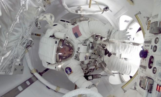 An astronaut about to exit the International Space Station for a spacewalk: Watch out for radioactive particles!