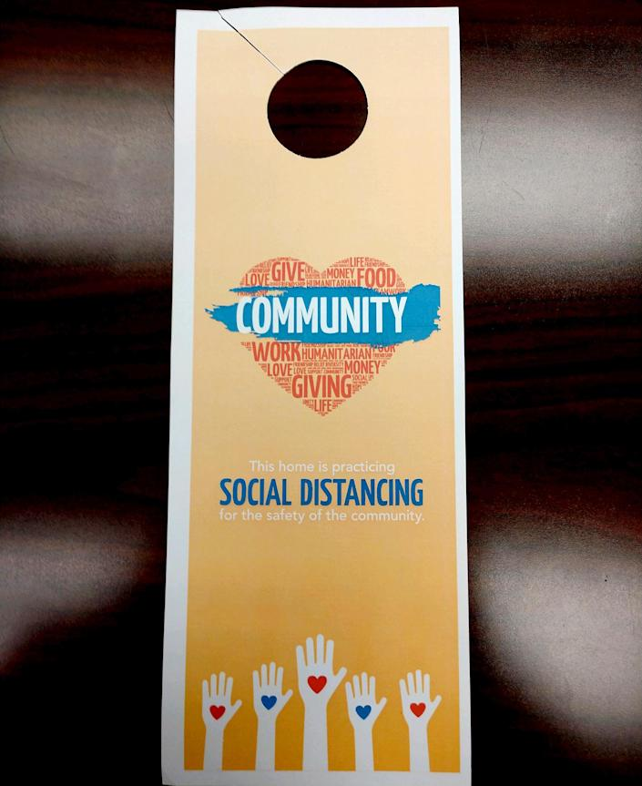 Starr County officials created and distributed door hangers to encourage social distancing. (Rio Grande City government)