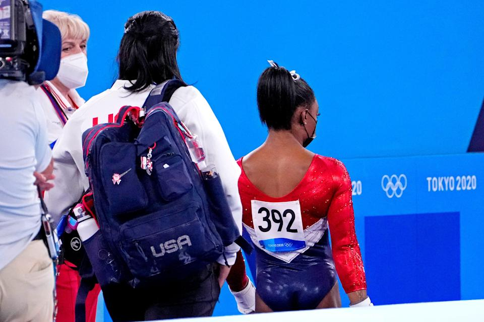 Simone Biles (USA) walks off the floor after the first rotation during the Tokyo 2020 Olympic Summer Games at Ariake Gymnastics Centre on July 27, 2021.