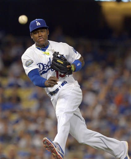 Los Angeles Dodgers shortstop Hanley Ramirez throws out Arizona Diamondbacks' Chris Young at first during the eighth inning of their baseball game, Thursday, Aug. 30, 2012, in Los Angeles. (AP Photo/Mark J. Terrill)