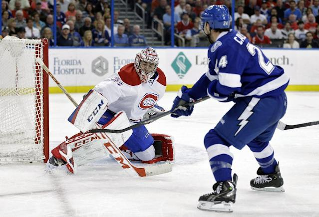 Montreal Canadiens goalie Carey Price (31) can't get his blocker on a goal by Tampa Bay Lightning right wing Ryan Callahan (24) during the second period of an NHL hockey game Tuesday, April 1, 2014, in Tampa, Fla. (AP Photo/Chris O'Meara)