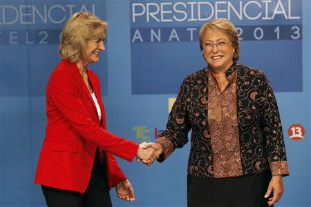 Chilean presidential candidates Michelle Bachelet and Evelyn Matthei shake hands during a live televised debate in Santiago