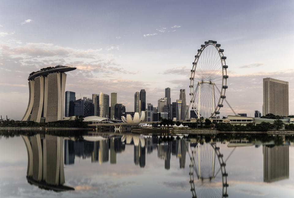 Singapore skyline at dawn, showing the Marina Bay Sands and the Flyer.