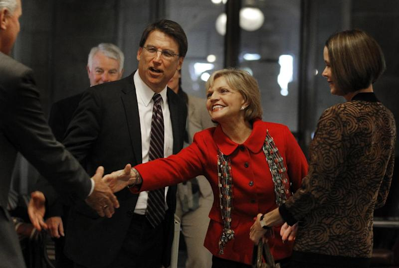 Governor-elect Pat McCrory introduces former Charlotte City Council member John Lassiter to Gov. Beverly Perdue Thursday Nov. 8, 2012. Lassiter is McCrory's senior chairman of transition operations. At right is his wife Ann McCrory. (AP Photo/The News & Observer, Chuck Liddy)