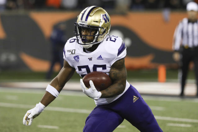Washington tailback Salvon Ahmed carries the ball during the first half of the team's NCAA college football game against Oregon State in Corvallis, Ore., Friday, Nov. 8, 2019. (AP Photo/Amanda Loman)