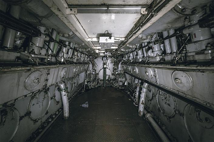 <p>Bob says the warships at the ship cemetery in France are some of the most interesting as theyre so cramped, beautiful and often difficult to enter, often requiring him to swim in the chilly waters and use a grappling hook to board. (Photo: Bob Thissen/Caters News) </p>