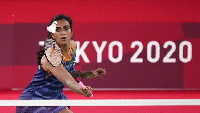 Ace Indian shuttler PV Sindhu booked her place in the women's singles semi-finals with a convincing 21-13, 22-20 win over Japan's Akane Yamaguchi. She will play her last-four clash on Saturday. AP