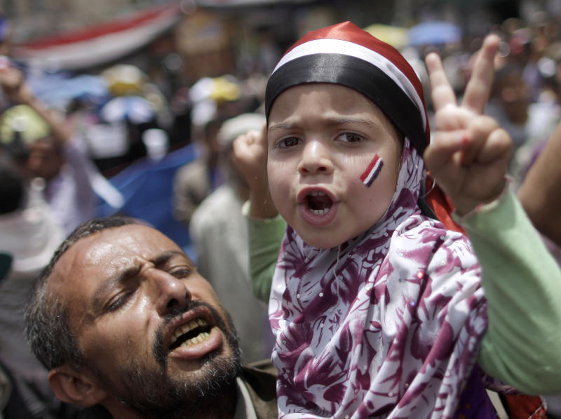 A Yemeni girl held by her father, chants slogans along with anti-government protestors during a demonstration demanding the resignation of Yemeni President Ali Abdullah Saleh, in Sanaa, Yemen, Wednesday, April 27, 2011. Witnesses said at least 18 Yemeni cities and towns have heeded an opposition call for a nationwide campaign of civil disobedience to bring down the long-serving president. (AP Photo/Muhammed Muheisen)