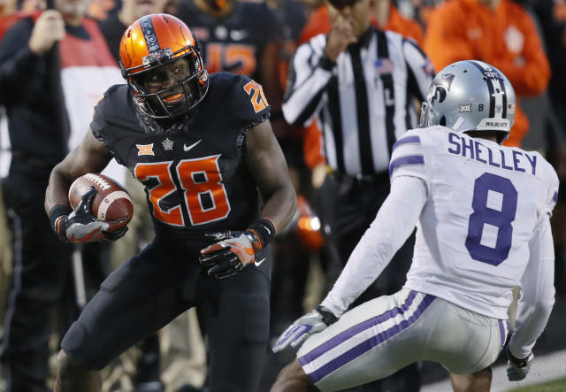 "Oklahoma State's <a class=""link rapid-noclick-resp"" href=""/ncaaf/players/242785/"" data-ylk=""slk:James Washington"">James Washington</a> averages over 20 yards a catch.  (AP Photo/Sue Ogrocki, File)"