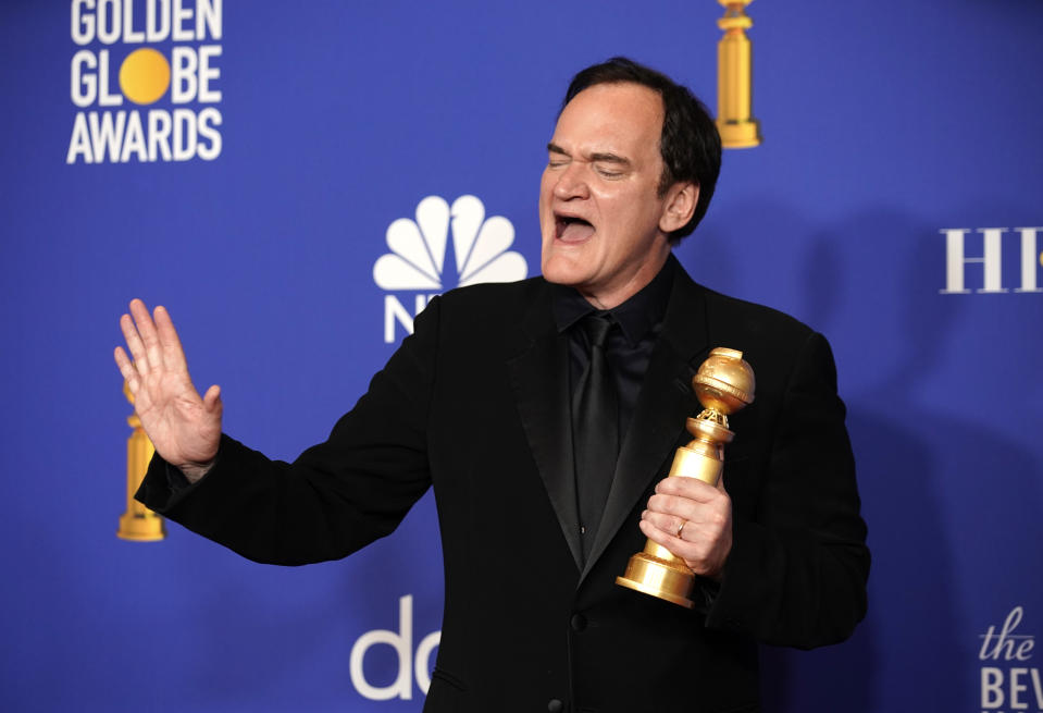 77th Golden Globe Awards - Photo Room - Beverly Hills, California, U.S., January 5, 2020 - Quentin Tarantino poses backstage with one of two awards that he won on the evening. REUTERS/Mike Blake