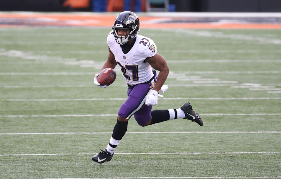 CINCINNATI, OHIO - JANUARY 03:  J.K. Dobbins #27 of the Baltimore Ravens runs with the ball against the Cincinnati Bengals at Paul Brown Stadium on January 03, 2021 in Cincinnati, Ohio. (Photo by Andy Lyons/Getty Images)