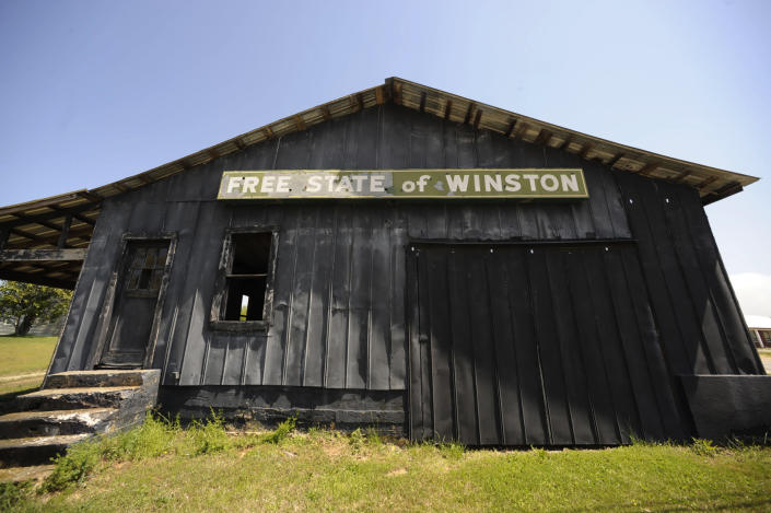 An abandoned building adorned with the age-old nickname of Winston County, stands near Double Springs, Ala., Monday, April 5, 2021. The county, which tried to secede from Alabama at the start of the Civil War, is trying to get more people immunized but running into problems with both supply and public willingness. (AP Photo/Jay Reeves)