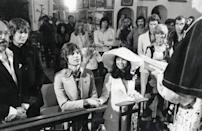 <p>Mick Jagger sits next to his bride, Bianca Pérez-Mora Macias, during their wedding ceremony in a small church in St. Tropez. </p>